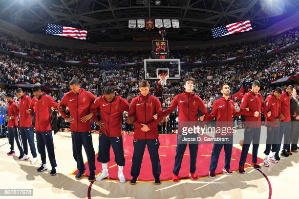 The Cleveland Cavaliers stand on the court for the National Anthem before the game against the Boston Celtics on October 17 2017 at Quicken Loans...