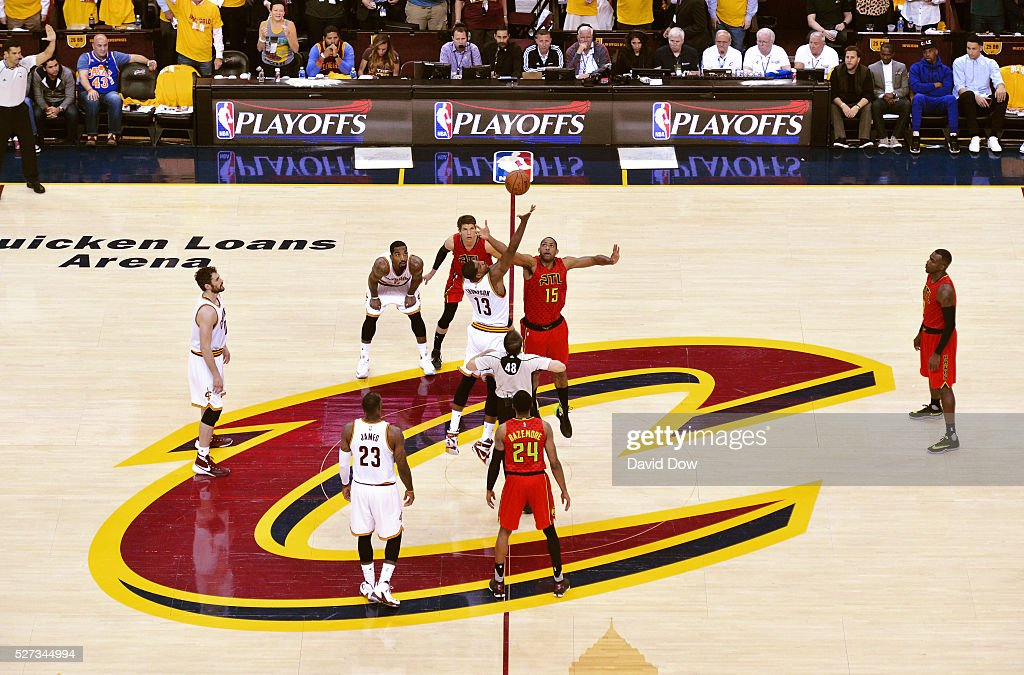 The Cleveland Cavilers and the Atlanta Hawks stand during the National Anthem Atlanta Hawks during game one of the Eastern Conference Playoffs at Quicken Loans Arena on May 2, 2016 in Cleveland, Ohio.