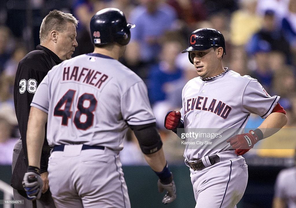 The Cleveland Indians' Asdrubal Cabrera is greeted by Travis Hafner (48) after scoring on a single by Michael Brantley in the third inning against the Kansas City Royals on Friday, September 21, 2012, at Kauffman Stadium in Kansas City, Missouri.
