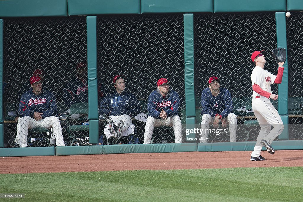 The Cleveland Indians bullpen staff watch right fielder Drew Stubbs #11 of the Cleveland Indians catch a fly ball during the ninth inning against the Chicago White Sox at Progressive Field on April 14, 2013 in Cleveland, Ohio. The White Sox defeated the Indians 3-1.