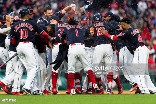 The Cleveland Indians celebrate after a walkoff win in the tenth inning over the Chicago White Sox during the Cleveland Indians home opening game at...