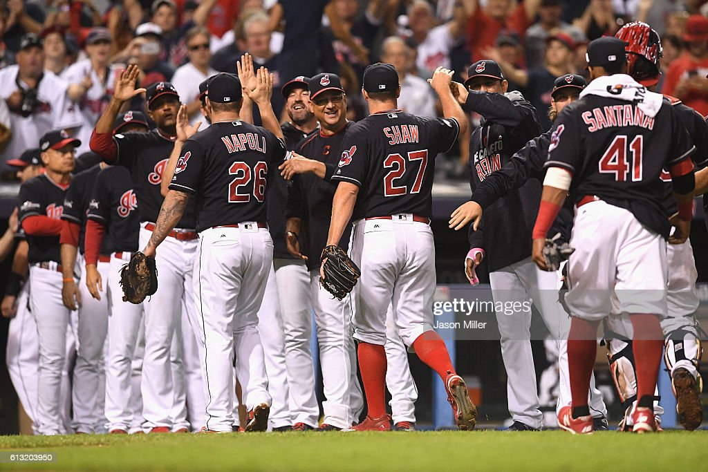 The Cleveland Indians celebrate after defeating the Boston Red Sox 60 in game two of the American League Divison Series at Progressive Field on...