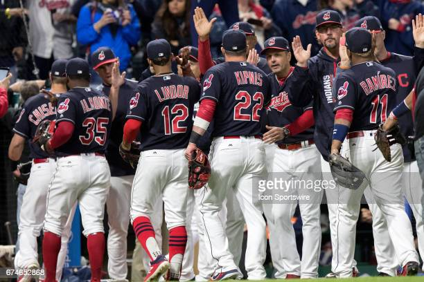 The Cleveland Indians celebrate following the Major League Baseball game between the Houston Astros and Cleveland Indians on April 27 at Progressive...