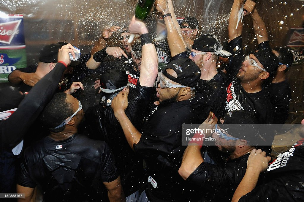 The Cleveland Indians celebrate with champagne in the clubhouse after a win of the game against the Minnesota Twins on September 29, 2013 at Target Field in Minneapolis, Minnesota. The Indians defeated the Twins 5-1 and clinched a American League Wild Card berth.
