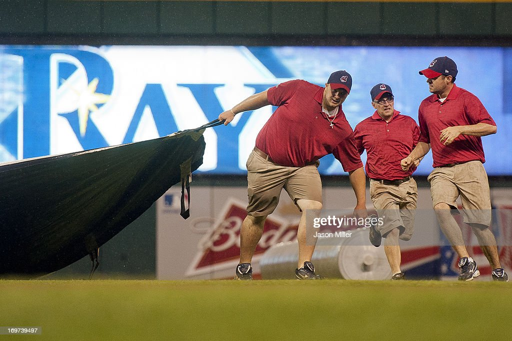 The Cleveland Indians grounds crew pulls the tarp over the field during a brief rain delay during the second inning of the game between the Cleveland Indians and the Tampa Bay Rays at Progressive Field on May 31, 2013 in Cleveland, Ohio.