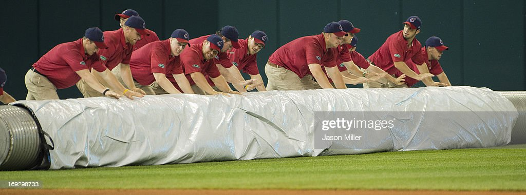 The Cleveland Indians grounds crew roll out the tarp for the second rain delay during the eighth inning between the Cleveland Indians and the Detroit Tigers at Progressive Field on May 22, 2013 in Cleveland, Ohio.