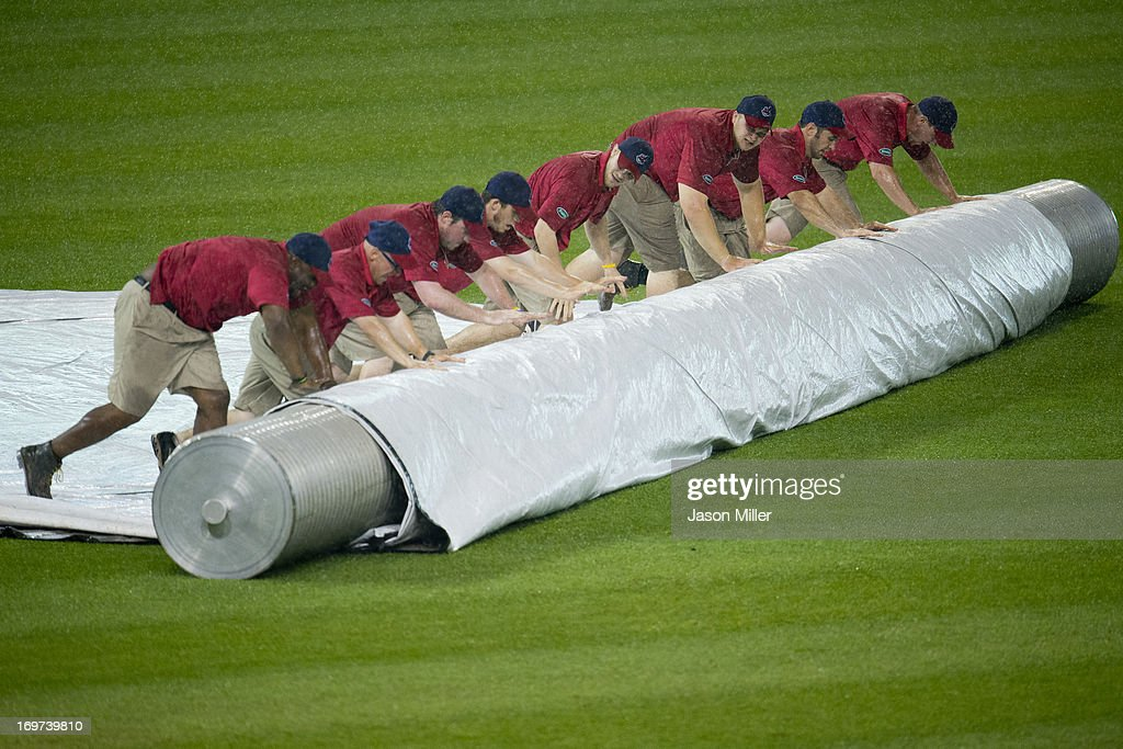 The Cleveland Indians grounds crew rolls out the tarp again during the second inning of the game between the Cleveland Indians and the Tampa Bay Rays at Progressive Field on May 31, 2013 in Cleveland, Ohio.