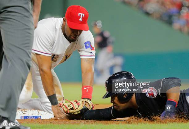 The Cleveland Indians' Jose Ramirez right is out at third base on a throw to Texas Rangers shortstop Elvis Andrus after a ball went into the outfield...