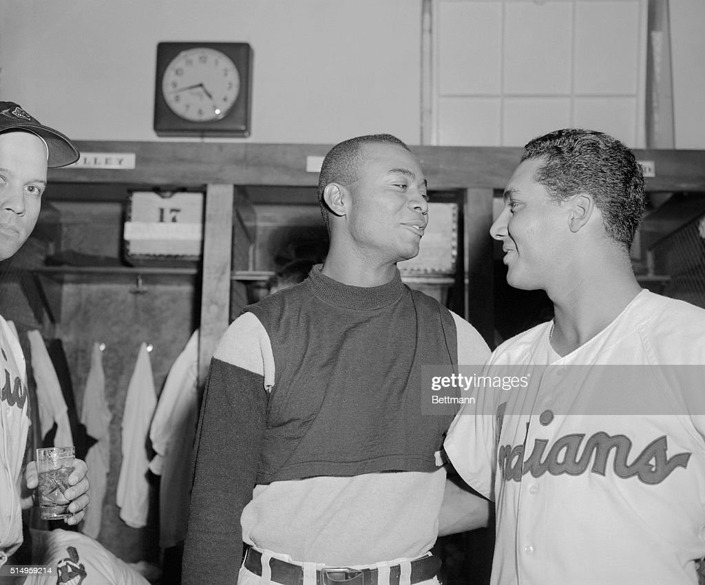 The Cleveland Indians took an 8 to 7 defeat in their last game of the season from the Detroit Tigers, but these two Indian players won three championship titles. Larry Doby (left), although missing from the final game, won the home run title with 32 and runs batted in title with 126. Bobby Avila (right) of .341. They are congratulating each other after the game.