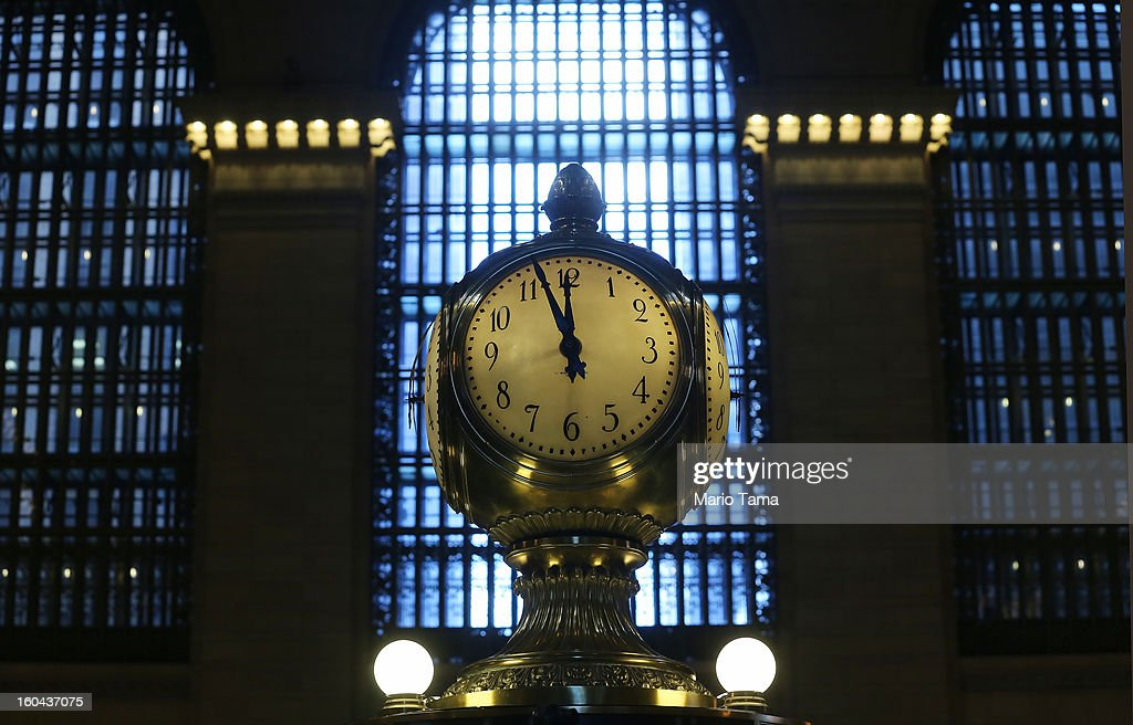 The clock above the Grand Central Terminal Information Booth, with faces made of opal, ticks on the day before the famed Manhattan transit hub turns 100 years old on January 31, 2013 in New York City. The terminal opened in 1913 and is the world's largest terminal covering 49 acres with 33 miles of track. Each day 700,000 people pass through the terminal where Metro-North Railroad operates 700 trains per day.