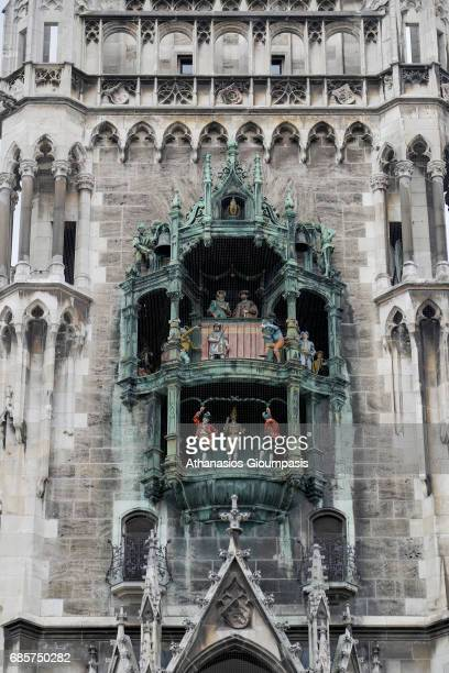 The clock chimes at the Munich New Town Hall on April 14 2017 in Munich Germany The clock with 43 bells which is triggered by six different reels...