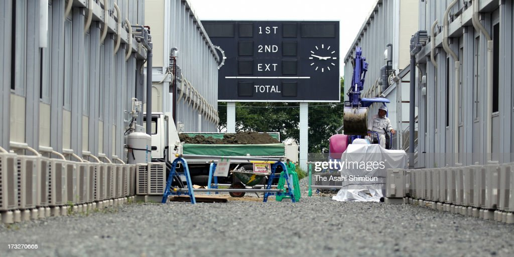 The clock of scoreboard had stopped at 14:46, when the magnitude 9.0 earthquake jolted on March 11, 2011, at temporary housing set up for Tokyo Electric Power Co staffs at former main stadium of J.Village, Japan Football Association (JFA) national training center on July 11, 2013 in Hirono, Fukushima, Japan. J.Village, 20 kilometers away from the Fukushima Daiichi Nuclear Power Plant, has been acting as the frontline base for 3,000 workers of the crippled nuclear Power Plant stabilization. JFA is to make a plan to restore the facility as national training center after some of nulcear disaster restoration functions are now relocated to closer site of the plant.
