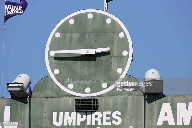 The clock on the scoreboard at Wrigley Field in Chicago Illinois during the game between the Chicago Cubs and the San Francisco Giants on September 2...