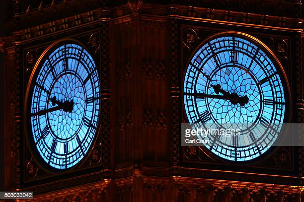 The clockface of Big Ben is lit up blue in aid of Unicef on December 31 2015 in London England Thousands of people have bought tickets to stand on...