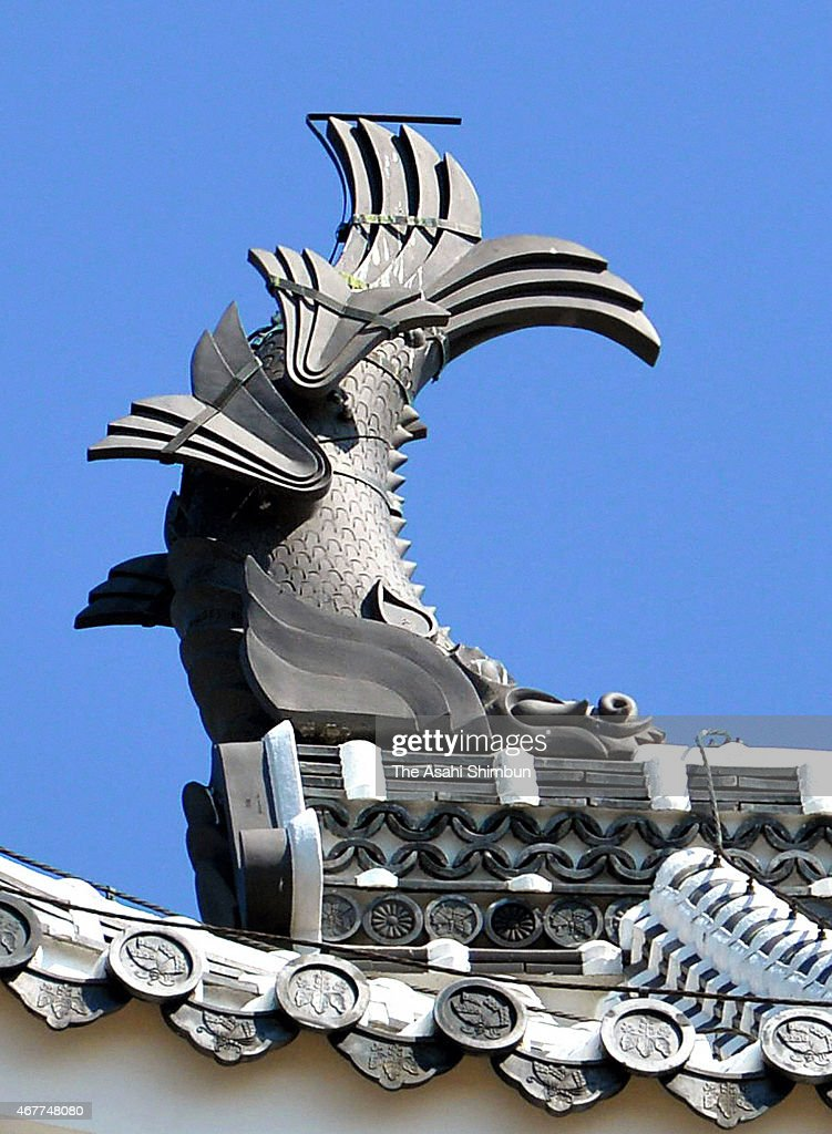 The close up of the 'ShachiGawara' fish shaped tile ornament of charm placed on the main tower of Himeji Castle is pictured on March 27 2015 in...