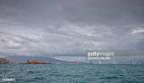 The clouds cover the top of the Vesuvio volcano seen from the bay of Naples during the final at the America's Cup World Series on April 15 2012 off...
