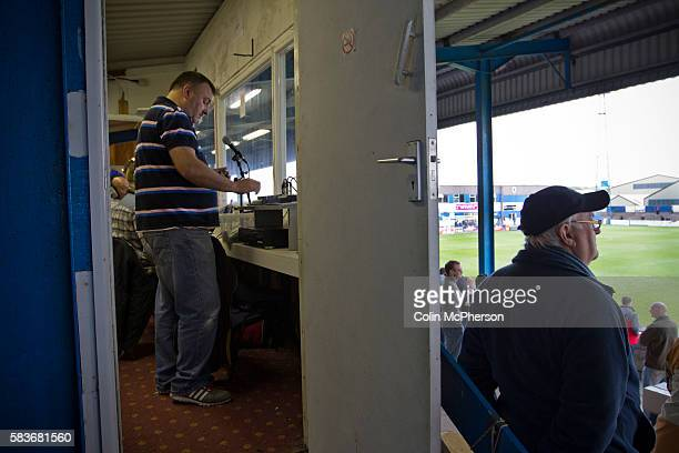 The club announcer cues up some halftime music at Barrow AFC's Furness Building Society Stadium during the Barrow v Newport County Conference...