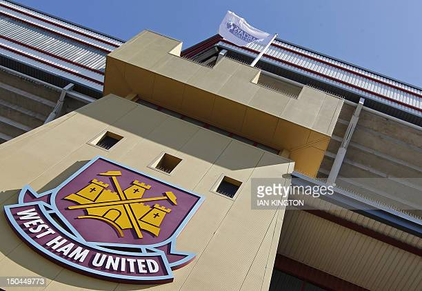 The club badge is seen on the outside of the stadium before the English Premier League football match between West Ham United and Aston Villa at the...