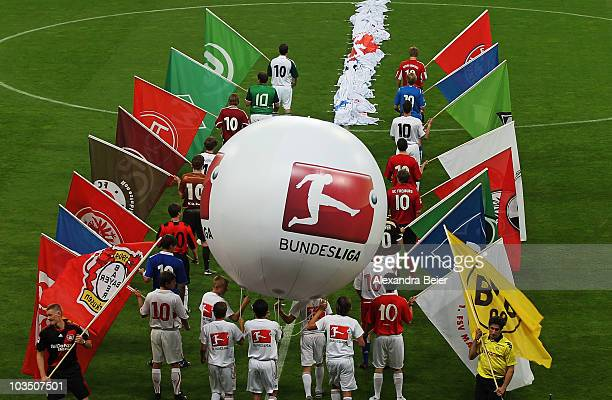 The club logos of all German first league Bundesliga clubs are shown before the season's first Bundesliga match between FC Bayern Muenchen and VfL...