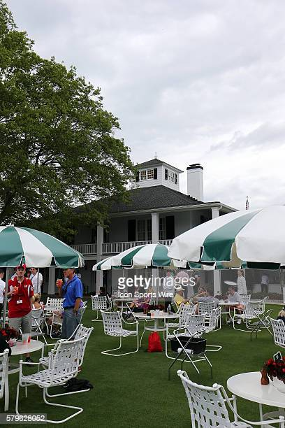 The clubhouse sits back as the patrons members guests are able to sit outside and enjoy a meal during the practice round for the 2015 Masters...