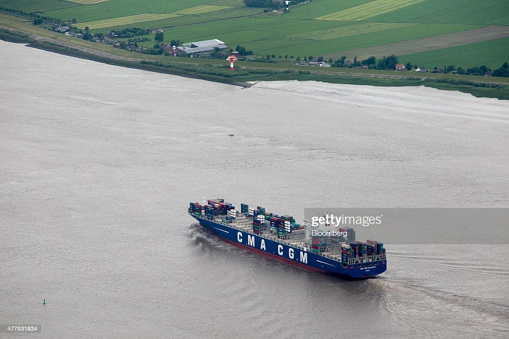 The CMA CGM Callisto container ship sails on the river Elbe in this aerial photograph taken near Hamburg Germany on Tuesday June 16 2015 German...