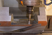 The CNC milling machine cutting the mold part.