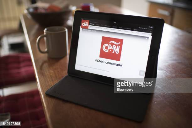The CNN en Espanol logo is displayed on a tablet device for a photograph as it streams for free on Youtube Inc amid the government taking CNN en...
