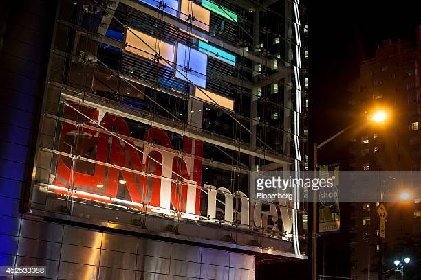 The CNN logo is displayed at the Time Warner Center in New York US on Monday July 21 2014 Rupert Murdoch's 21st Century Fox Inc is considering using...