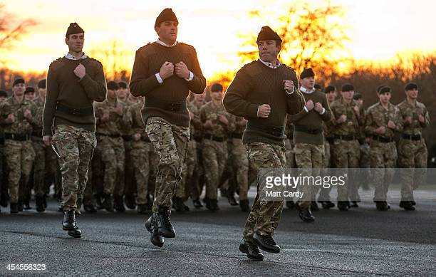 The CO 4 RIFLES Lt Col Tom Bewick leads soldiers from the 4th Battalion The Rifles from the parade ground after they received medals to mark their...
