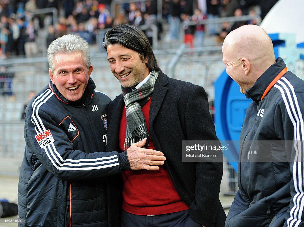 The coach Jupp Heynckes of Bayern Munich (L) shares a laugh with coach of Basel, Murat Yakin before the friendly match between FC Basel and Bayern Munich at Stadium St. Jakob on January 12, 2013 in Basel, Switzerland.