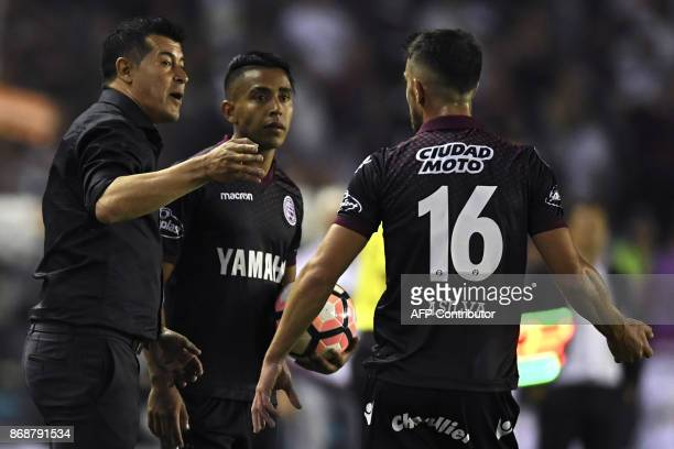 The coach of Argentina's Lanus Jorge Almiron speask to players during their Copa Libertadores semifinal second leg football match against Argentina's...