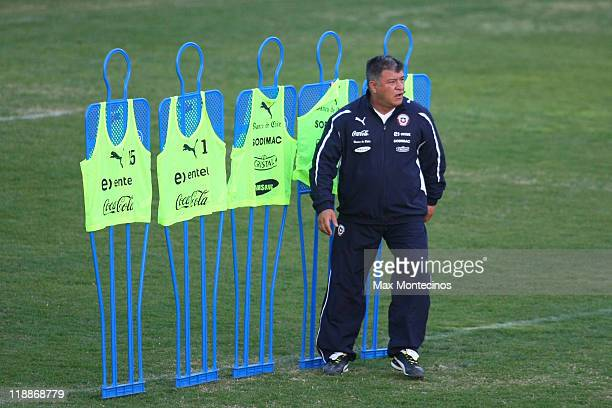 The coach of Chile Claudio Borghi looks to his players during a trainning session during the Copa America 2011 on July 11 2011 in Mendoza Argentina