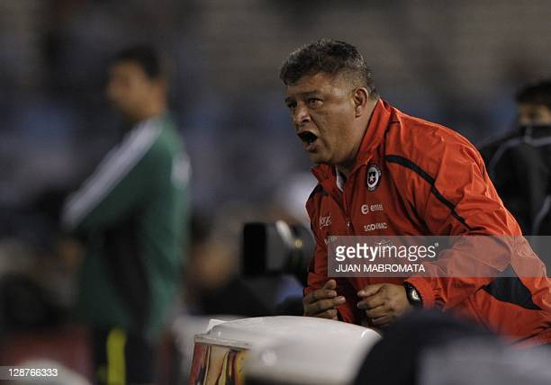 The coach of Chile's national football team Claudio Borghi gives instructions to his players during the Brazil 2014 World Cup South American...
