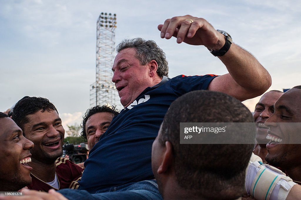 The coach of Fluminense, Abel Braga, is lifted up in the air after winning the Brazilian championship before the end of the season, following their 3-2 victory over Palmeiras, at Prudentao stadium in Presidente Prudente, in the state of Sao Paulo, Brazil, on Novemeber 11, 2012. AFP PHOTO/Yasuyoshi CHIBA