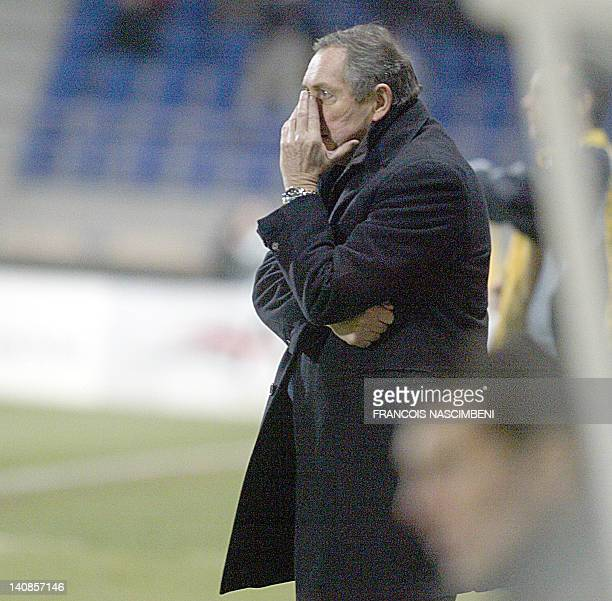 The coach of Lyon Gerard Houllier reacts after Troyes scored a goal during the prolongations during their French L1 football match TroyesLyon 04...