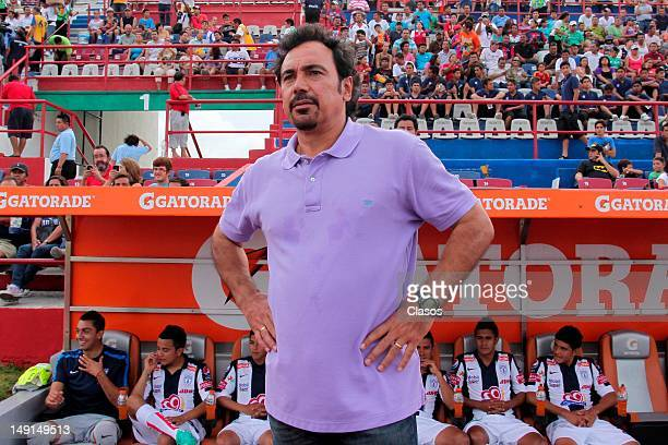 The coach of Pachuca Hugo Sanchez observes the match between Pachuca and Atlante as part of the Tournament Apertura 2012 at Olimpic Stadium on July...