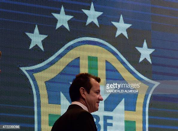 The coach of the Brazilian national football team Dunga walks to take a seat before announcing the 23player roster for the upcoming Copa America...