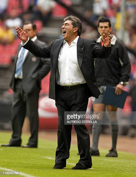 The coach of the mexican team America Carlos Reinoso reacts during a Mexican Clausura tournament match against Cruz Azul at the Azteca Stadium in...