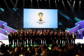 The coaches of the national football teams of the 32 nations that have qualified for the 2014 World Cup Finals pose on stage with FIFA President...