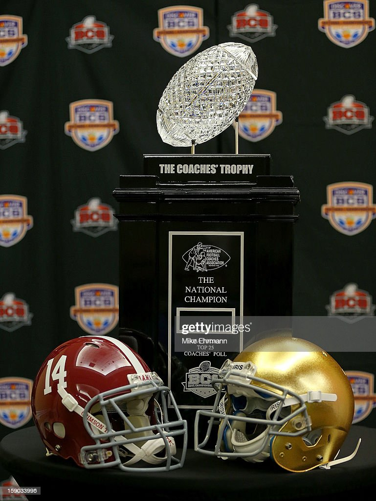 The Coaches Trophy sits with the helmets for the Notre Dame Fighting Irish and the Alabama Crimson Tide during the Discover BCS National Championship Head Coaches Press Conference on January 6, 2013 in Fort Lauderdale, Florida.