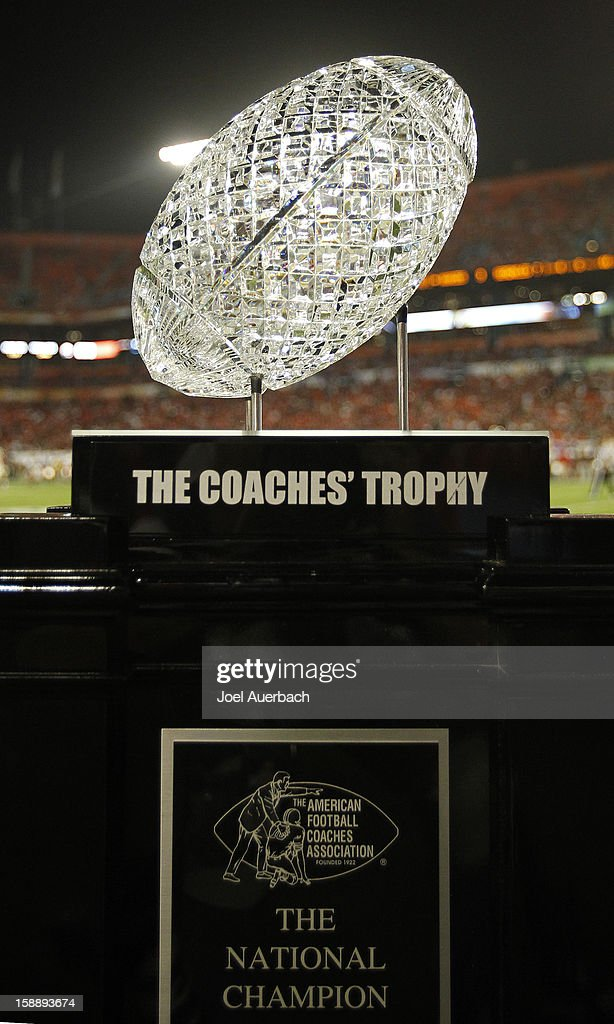 The Coaches' Trophy, which is presented to the team that wins the National Championship, is displayed on the sideline during the game between the Florida State Seminoles the Northern Illinois Huskies during the 2013 Discover Orange Bowl at Sun Life Stadium on January 1, 2013 in Miami, Florida. The Seminoles defeated the Huskies 31-10.