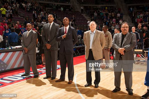 The coaching staff of the Detroit Pistons line up for the national anthem before the game against the Chicago Bulls on October 7 2014 at The Palace...
