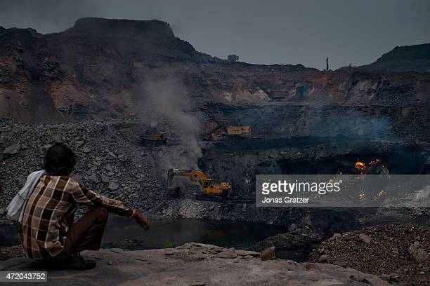 The coal mine in Jharia is oozing fire methane and other toxic gases spew from the open wounds of the Earth's crust Jharia has been burning for over...