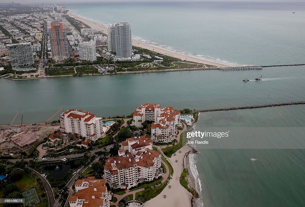 The coast line of Miami Beach and part of Fisher Island (bottom) are seen June 3, 2014 in Miami, Florida. According to numerous scientists, south Florida could be flooded by the end of the century as global warming continues to melt the Arctic ice, in turn causing oceans to rise. U.S. President Barack Obama and the Environmental Protection Agency yesterday announced a rule that would reduce the nation's biggest source of pollution, carbon emissions from power plants, 30% by 2030 compared to 2005 levels. It is widely believed that these emissions are a main cause of global warming.