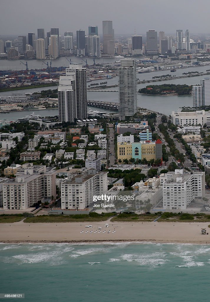 The coast line of Miami Beach and the City of Miami (in background) are seen June 3, 2014 in Miami, Florida. According to numerous scientists, south Florida could be flooded by the end of the century as global warming continues to melt the Arctic ice, in turn causing oceans to rise. U.S. President Barack Obama and the Environmental Protection Agency yesterday announced a rule that would reduce the nation's biggest source of pollution, carbon emissions from power plants, 30% by 2030 compared to 2005 levels. It is widely believed that these emissions are a main cause of global warming.