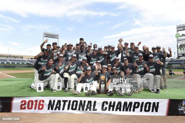 The Coastal Carolina Chanticleers pose for a group photo after their victory over the University of Arizona during Game 3 of the Division I Men's...