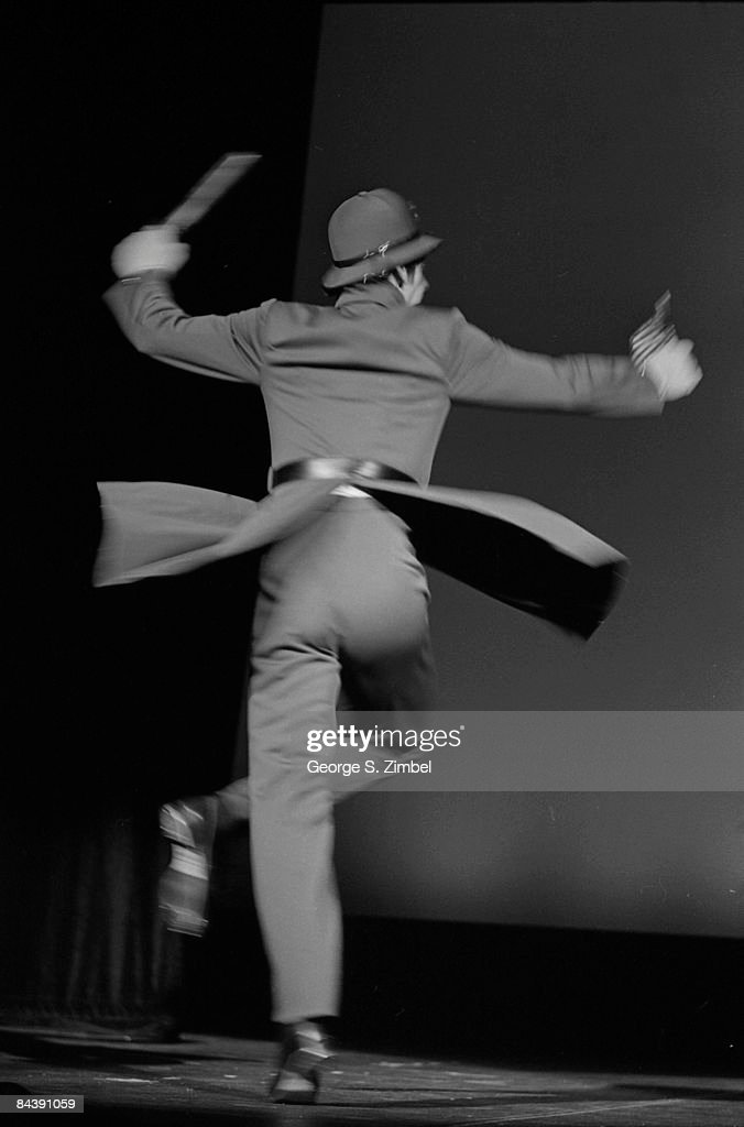 The coattails on a dancer's costume unfold out as he twirls dynamically on stage, 1976. Prince Edward Island,