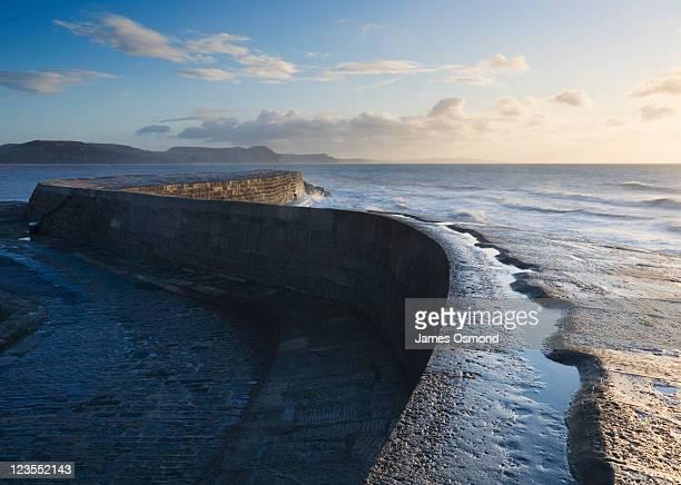 The Cobb at Sunrise. Lyme Regis. Dorset. England. UK.