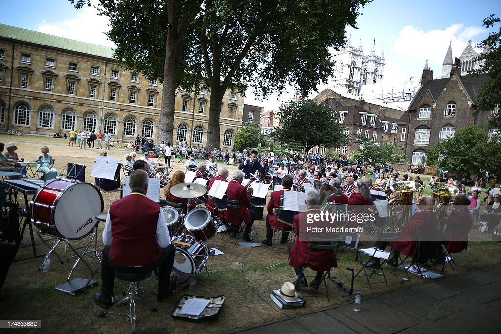The Cobham Brass Band plays in College Garden in the grounds of Westminster Abbey on July 24, 2013 in London, England. A series of lunchtime concerts entitled 'Brass on the Grass' are being held between July 24 and August 28, 2013.