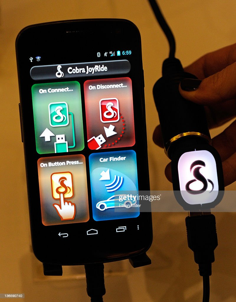 The Cobra JoyRide car charger by Cobra Electronics is displayed during a press event at The Venetian for the 2012 International Consumer Electronics Show (CES) January 8, 2012 in Las Vegas, Nevada. The JoyRide works with Android phones and can automatically trigger preset phone functions like enabling GPS or disabling Wi-Fi with the press of a single button. It will be available for USD 39 in the second quarter of 2012. CES, the world's largest annual consumer technology trade show, runs from January 10-13 and is expected to feature 2,700 exhibitors showing off their latest products and services to about 140,000 attendees.